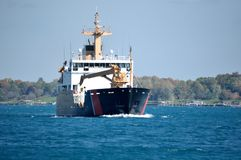Coast Guard Seagoing Buoy Tender. Heading down river during mid fall Royalty Free Stock Photos