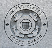 Coast guard seal. The seal of the United States Coast Guard engraved into granite royalty free stock photography