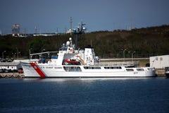 Coast guard ship on dock Stock Photos