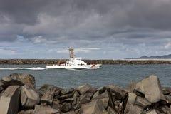 Coast Guard ship in Yaquina Bay. Stock Image