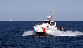 Coast Guard Speedboat. A Coast Guard speedboat under full power on Lake Michigan Stock Images