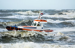 Coast guard during storm. In ocean Stock Photos