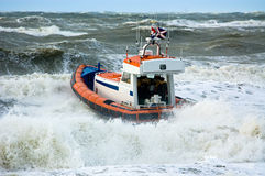 Coast guard during storm. In ocean Stock Photography