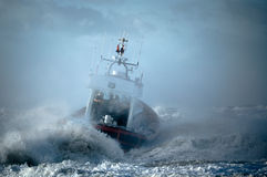 Coast guard during storm. In ocean Stock Images