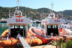 Coast guards in the harbour of Porto Santo Stefano, Italy Stock Image