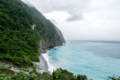Coast in Hualien, Taiwan. Mountain with ocean, cloudy sky, colorfu sea, Coast in Hualien, Taiwan Royalty Free Stock Photos