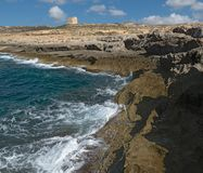 Coast of the island of Gozo Malta, Dwejra Tower. Northwestern coast of the island of Gozo Malta, Dwejra Tower Royalty Free Stock Images