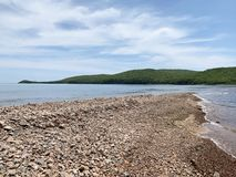 Coast of the island of Shkot from the side of Russkiy Russian, Russky island in spring sunny day. Vladivostok, Russia.  stock photos