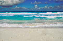 Coast with its azure water and white sand, sky, clouds Stock Photos