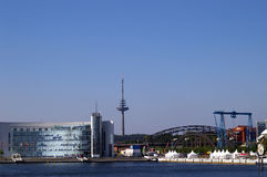 Coast of Kiel, Germany. A picture of the coastal area in Kiel, Germany, with a hotel-like building and an amusement park Royalty Free Stock Photography
