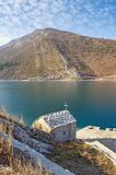 Coast of Kotor Bay and Church of Our Lady of the Snow on sunny winter day. Montenegro. Coast of Kotor Bay and Church of Our Lady of the Snow 16 Century on a Royalty Free Stock Image