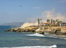 The coast of La Jolla with a helicopter in the sky stock photo