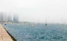 Coast of Lake Michigan in the fog with parked boats. royalty free stock images