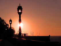 Coast with lampposts at sunset Stock Image