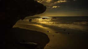Coast of lava rock at sunset on Royalty Free Stock Images