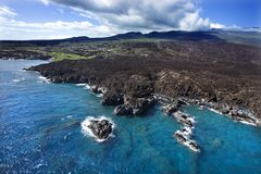 Coast with lava rocks. Stock Photos