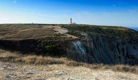 The coast and lighthouse, cape Espichel, Portugal Stock Photos