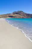 Coast line of beach with blue transparent water on Crete island Stock Images