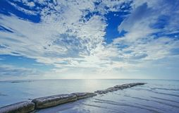 Line of stounes going to the ocean. Coast line in island Holbox, Mexico Stock Image