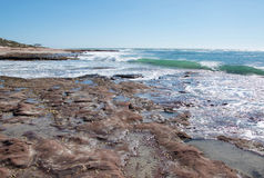 Coast Line in Kalbarri. Turquoise Indian Ocean coral coast line with sandstone rock and fringe reef at Jake's Point beach under clear skies in Kalbarri, Western Royalty Free Stock Images