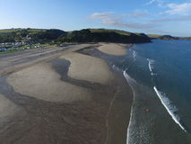 The coast line of Pentewan Sands. The sandy coastline of Pentwean sands in Cornwall south West England, the shot was taken by an DJI Inspire 1 drone. The tide is stock photography