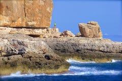Rock climbing in Mallorca. Coast line and people climbing the rocks in Mallorca Stock Photos