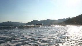 Sea coast line washed by waves view in Turkey stock footage