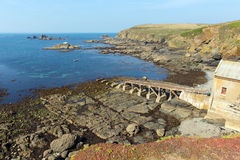 Coast at the Lizard with lifeboat house Cornwall Englan in summer on calm blue sea sky day. Disused RNLI lifeboat house the Lizard peninsula Cornwall England UK Royalty Free Stock Photos