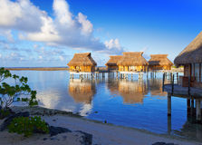The coast and lodges on water.Sea tropical landscape in a sunny day Stock Images