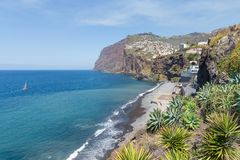 Coast of Madeira island with hiigh cliffs and small villages stock image