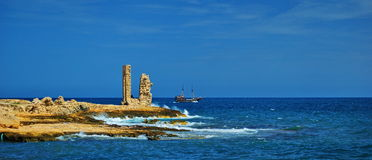 Coast of Mahdia. Rocky coast of Mahdia,Tunisia with ship in background stock photo