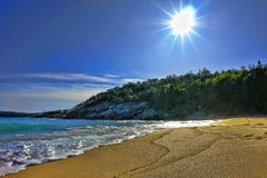 Coast of Maine Beach in Acadia National Park. Sand beach on the Maine coast in Acadia National Park in late afternoon with glowing sun royalty free stock images