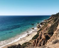 The coast of Malibu California. With blue sky's and Pacific Ocean with cliffs and mountains Stock Photography