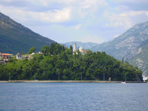Coast of Montenegro. View from the sea on church on the hill Stock Photo