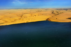 The coast in Namibia. Aerial view on the coast in Namibia where dunes of the Namib desert meet with Atlantic ocean, Africa royalty free stock photo