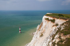 On the coast near Eastbourne. White chalk cliffs and aerial view Lighthouse Beachy Head, Eastbourne, East Sussex, England royalty free stock photos