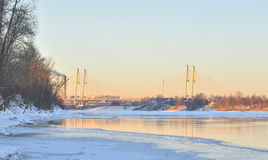 Coast of Neva River and Cable stayed bridge at winter. Royalty Free Stock Photography