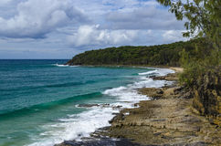 Coast at Noosa Heads. Rocky beach in the Noosa National Park stock photography