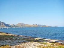 Coast north of Majorca, view towards Formentor, stony beach in front Stock Photography