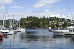 Coast of Norway, with yacht and charming cottages in the backgro. Und, summer Stock Photo