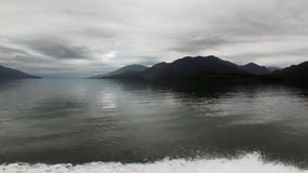 Coast of ocean and green mountain view from boat in Patagonia Argentina. stock video footage