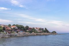 Dense building in the seaside town. The coast of Old Nessebar in Bulgaria. City on the Black Sea. Travel to Europe. Seaside resort town. Summer holiday in the royalty free stock image