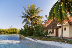 Coast of one of the islands of Cuba - sea, palms and bungalow. Stock Image