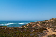 Coast in ortugal. The coastline in portugal showing the ocean, cliffs, beach, and waves Royalty Free Stock Photo