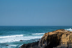 Coast in ortugal. The coastline in portugal showing the ocean, cliffs, beach, and waves Stock Photos