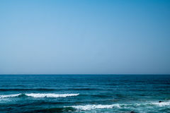 Coast in ortugal. The coastline in portugal showing the ocean, cliffs, beach, and waves Royalty Free Stock Image