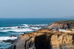 Coast in ortugal. The coastline in portugal showing the ocean, cliffs, beach, and waves Stock Photo