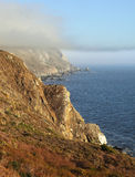 Coast of Pacific ocean  and a morning fog Stock Photos