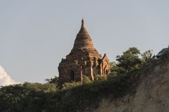 Coast with the pagodas of Bagan. Coast of a river overlooking the ancient pagodas and temples of Bagan. Myanmar stock photography