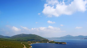 Coast panorama. Sardinia coast panorama with the blue sea and sky royalty free stock photo